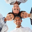 Upward view of a team of business men with their heads together