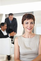 An attractive business woman smiling confidently in the office