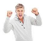 Portrait of a mature man excited with his hands raised and isolated on a white background