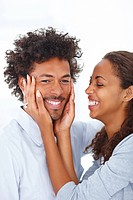 Portrait of a young cute gorgeous romantic African American couple having a good time with each other
