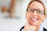 Cheerful gorgeous happy female with spectacles smiling towards camera
