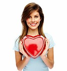 Portrait of a attractive young woman holding a red heart over white background