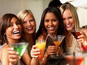 Closeup of a happy young girls holding drinks