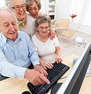 Senior people working at home on computer