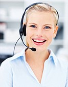 We are here to help _ Smiling woman wearing headset