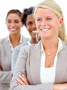 Smiling business people standing with arms folded