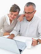 Mature couple using laptop together