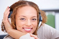 Closeup portrait of a happy lady wearing headphones