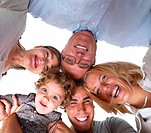 Closeup portrait of a happy family in circle against white background