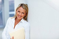 Portrait of a beautiful business woman holding a portfolio