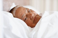 Closeup of an elderly woman having sleepless nights in bed