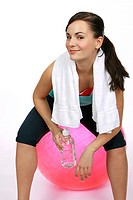 Fitness woman have break, drinking mineral water from a bootle