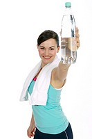 Fitness woman drinking water from a bottle
