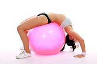 Fitness woman exercising on a fitness ball