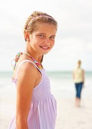 Portrait of a cute young girl smiling on the beach on a sunny day