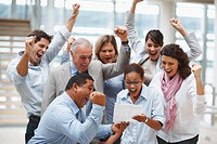 Group of business colleagues celebrating over finalization of a contract