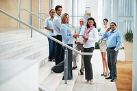 Business colleagues standing in a group at the staircase