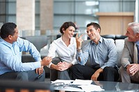 Group of successful multi ethnic business team having a casual talk