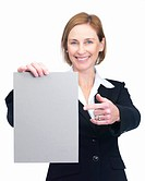 Portrait of happy middle aged businesswoman pointing at a blank billboard isolated over white background