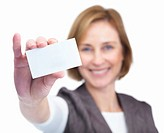Portrait of happy mature female showing blank business card isolated over white background