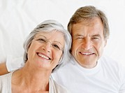 Closeup portrait of a cute retired couple sitting and smiling together