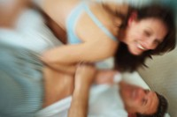 Blur image of a couple enjoying a passionate moment in bed