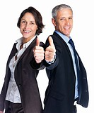 Successful business man and woman gesturing a thumbs up together against white