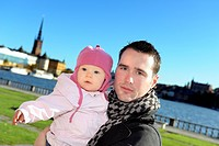 Father with his baby daughter, Sweden.