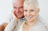 Closeup portrait of a happy elderly senior couple smiling together