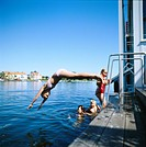 Children swiming at a jetty