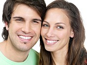 Closeup portrait of a cute romantic couple against white