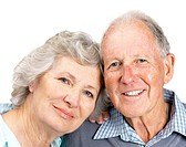 Closeup portrait of a happy senior couple smiling together on white background