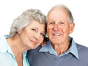 Closeup portrait of a sweet old couple smiling together on white background