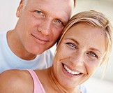 Closeup portrait of happy mature couple smiling