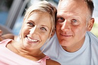 Closeup portrait of an attractive middle aged couple smiling together