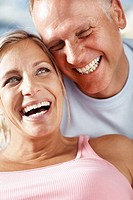 Closeup portrait of happy middle aged couple enjoying themselves