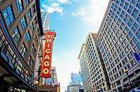 Wide angle photo of the Chicago Theatre marquee and buildings on State Street in Chicago Illinois