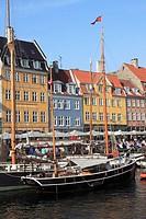 Denmark, Copenhagen, Nyhavn canalside leisure area,