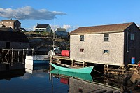 fishing shack and green boat at Port of historic fishing port Peggys Cove, Nova Scotia, Canada, North America.