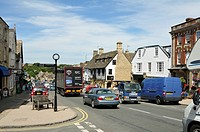 Summer traffic on Burford High Street, Cotswolds, UK