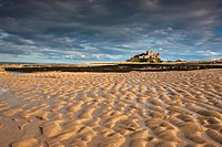 Bamburgh, Northumberland, England, View Of Bamburgh Castle From A Sandy Beach