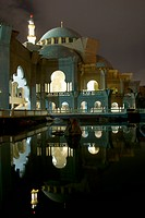 Kuala Lumpur, Malaysia, A Building By The Water Illuminated At Night