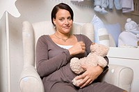 Pregnant women with Stuffed Animals.