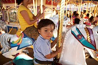 Mother and son on merry_go_round