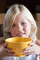Girl with hot drink in bowl