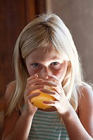 Girl with glass of orange juice