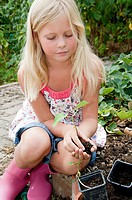 Girl gardening in vegetable garden