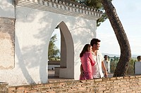 Young couple looking at view on holiday