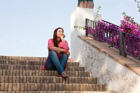 Young woman sitting on steps (thumbnail)
