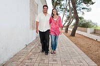 Young couple walking on holiday